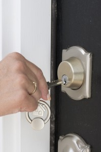 unlocking front door to a Spring Texas home
